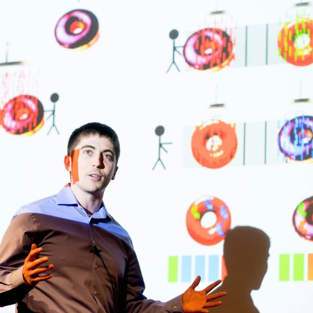 Sam Pollock of the Chemistry and Chemical Biology Program won the People's Choice award at the UCSF #gradslam for a presentation that used the metaphor of donut glaze and sprinkles to explain a new antibody therapy for tumors. Photo credit: Noah Berger.