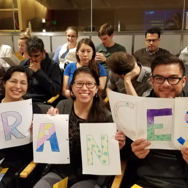 From @GladstoneInst on Twitter: Audience members show their support for Frances Cho at the 2018 UCSF Grad Slam.